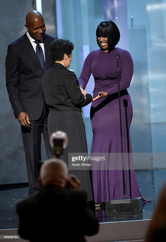 Vice Admiral Michelle Howard (C) accepts the Chairman's Award onstage from actor Dennis Haysbert (L) and NAACP Chairman of the National Board of Directors Roslyn M. Brock (R) onstage during the 44th NAACP Image Awards at The Shrine Auditorium on February 1, 2013 in Los Angeles, California.