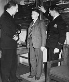Vice Admiral Sir Alexander Madden and naval recruiter J G Parnham measuring a new recruit at the recruiting office Eastcote Middlesex November 29th...