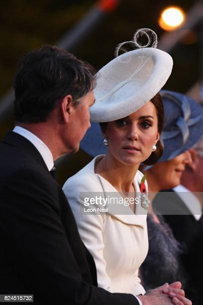 Vice Admiral Sir Timothy Laurence and Catherine Duchess of Cambridge look on as the story of the war in the Ypres region is told by performances and...