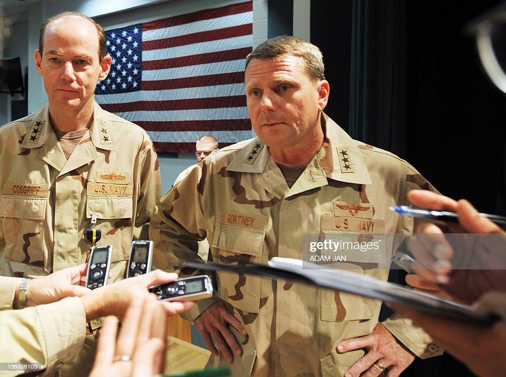 Vice Admiral William Gortney the new commander of the Bahrainbased US Navy's Fifth Fleet speaks to the press standing next to his predecessor Vice...