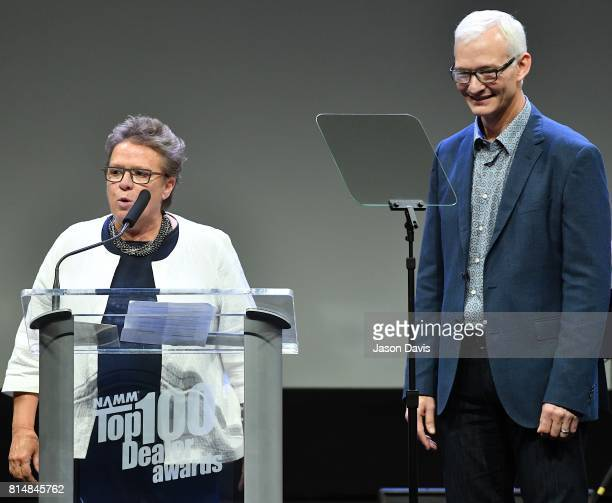Vice Chair Robin Walenta and Chairman Mark Goff speak during Top 100 Dealer Awards at Summer NAMM at Music City Center on July 14 2017 in Nashville...