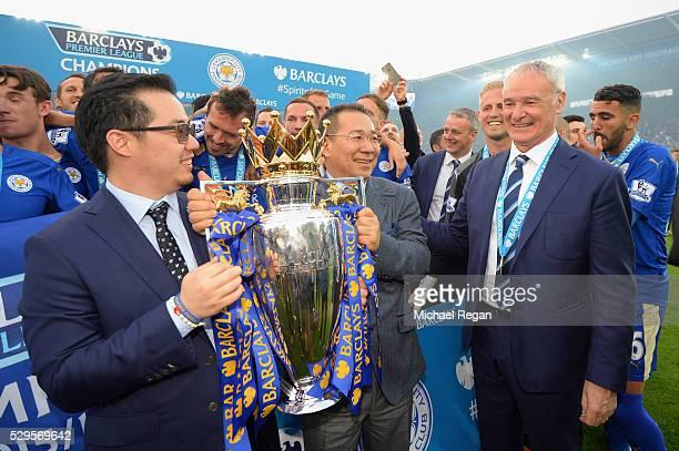 Vice chairman Aiyawatt Srivaddhanaprabha and Chairman Vichai Srivaddhanaprabha of Leicester City lift the Premier League trophy with Leicester...