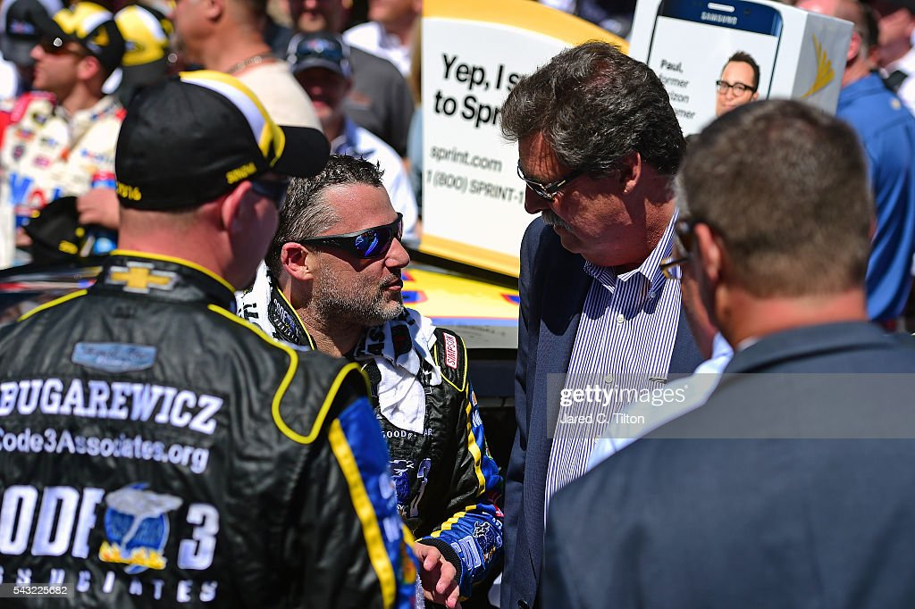 Vice Chairman Mike Helton congratulates <a gi-track='captionPersonalityLinkClicked' href=/galleries/search?phrase=Tony+Stewart+-+Race+Car+Driver&family=editorial&specificpeople=201686 ng-click='$event.stopPropagation()'>Tony Stewart</a>, driver of the #14 Code 3 Assoc/Mobil 1 Chevrolet, in Victory Lane after winning the NASCAR Sprint Cup Series Toyota/Save Mart 350 at Sonoma Raceway on June 26, 2016 in Sonoma, California.