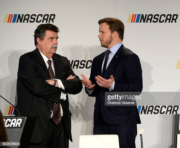 Vice Chairman Mike Helton left and Marcus Smith president and chief operating officer and director of NASCAR track owner Speedway Motorsports right...