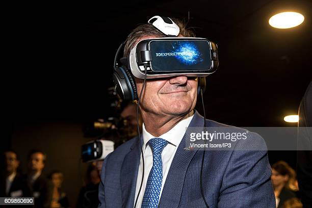 Vice Chairman of the Board of Directors and Chief Executive Officer at Dassault Systemes Bernard Charles wears a virtual reality helmet during the...