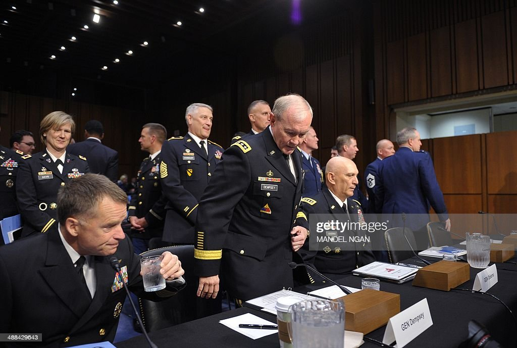 Vice Chairman of the Joint Chiefs of Staff Adm. James Winnefeld, Chairman of the Joint Chiefs of Staff Gen. Martin Dempsey, and Chief of Staff of the Army Gen. Raymond Odierno prepare for the start of the Senate Armed Services Committee hearing on Defense Department proposals relating to military compensation in the Hart Senate Office Building on Capitol Hill on May 6, 2014 in Washington, DC. AFP PHOTO/Mandel NGAN