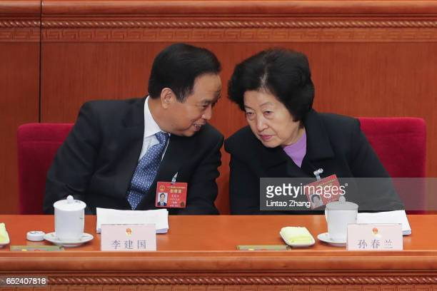 Vice chairman of the Standing Committee of the National People's Congress Li Jianguo talks with Sun Chunlan head of the United Front Work Department...