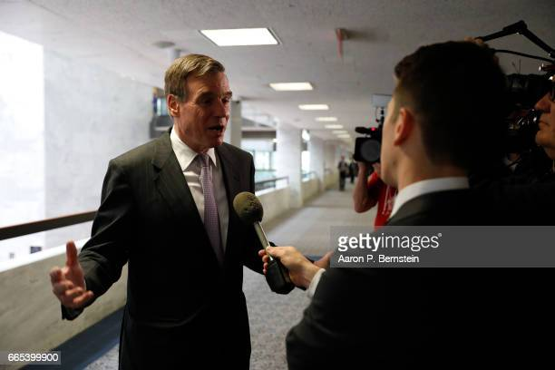 Vice Chairman Sen Mark Warner arrives for a meeting of the Senate Select Committee on Intelligence on Capitol Hill April 6 2017 in Washington DC The...