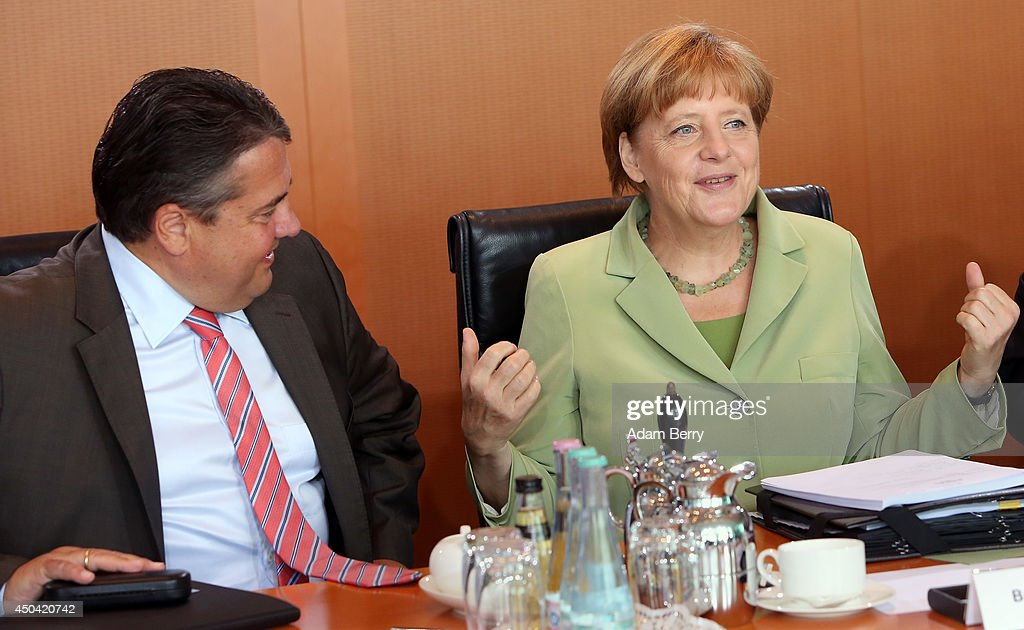 Vice Chancellor and Economy and Energy Minister <a gi-track='captionPersonalityLinkClicked' href=/galleries/search?phrase=Sigmar+Gabriel&family=editorial&specificpeople=543927 ng-click='$event.stopPropagation()'>Sigmar Gabriel</a> (SPD) (L) and German Chancellor <a gi-track='captionPersonalityLinkClicked' href=/galleries/search?phrase=Angela+Merkel&family=editorial&specificpeople=202161 ng-click='$event.stopPropagation()'>Angela Merkel</a> (CDU) arrive for the weekly German federal Cabinet meeting on June 11, 2014 in Berlin, Germany. High on the meeting's agenda was discussion over the country's arms export policies.