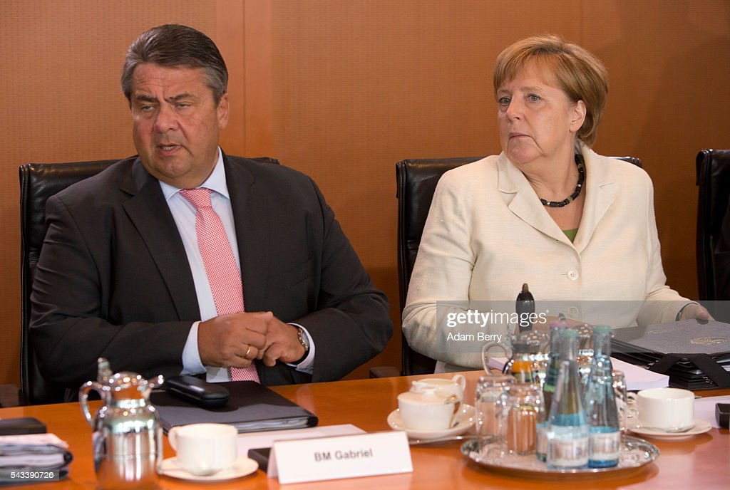 Vice Chancellor and Economy and Energy Minister <a gi-track='captionPersonalityLinkClicked' href=/galleries/search?phrase=Sigmar+Gabriel&family=editorial&specificpeople=543927 ng-click='$event.stopPropagation()'>Sigmar Gabriel</a> (SPD) (L) and German Chancellor <a gi-track='captionPersonalityLinkClicked' href=/galleries/search?phrase=Angela+Merkel&family=editorial&specificpeople=202161 ng-click='$event.stopPropagation()'>Angela Merkel</a> (CDU) arrive for the weekly German federal Cabinet meeting on June 28, 2016 in Berlin, Germany. High on the meeting's agenda was discussion of policies regarding the country's central intelligence agency (Bundesnachrichtendienst, or BND) abroad.
