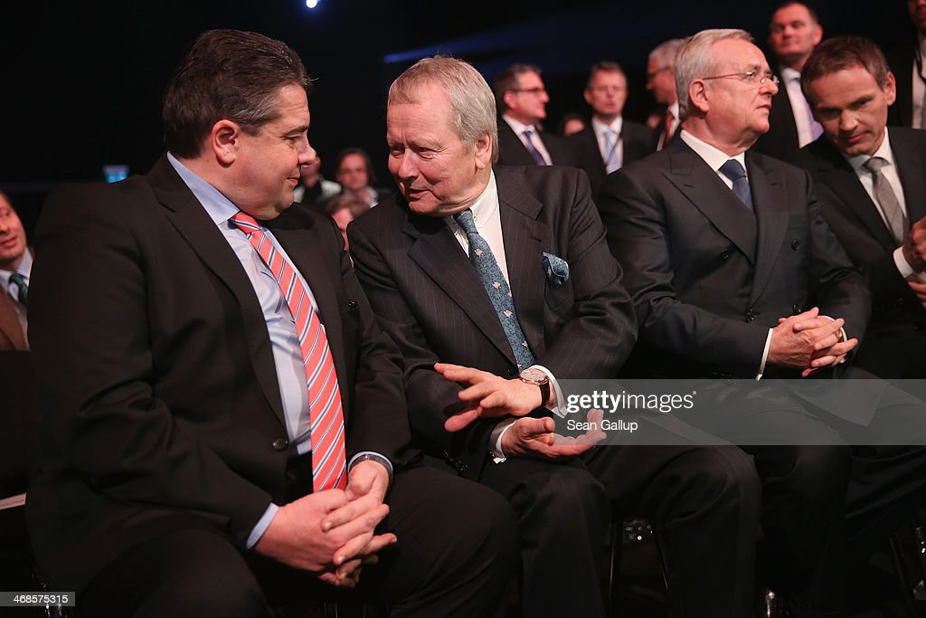 Vice Chancellor and Economy and Energy Minister <a gi-track='captionPersonalityLinkClicked' href=/galleries/search?phrase=Sigmar+Gabriel&family=editorial&specificpeople=543927 ng-click='$event.stopPropagation()'>Sigmar Gabriel</a> (L) chats with Porsche Governing Board Chairman Wolfgang Porsche (C) as Volkwagen Chairman <a gi-track='captionPersonalityLinkClicked' href=/galleries/search?phrase=Martin+Winterkorn&family=editorial&specificpeople=840091 ng-click='$event.stopPropagation()'>Martin Winterkorn</a> sits nearby at the official opening of the new Porsche Macan factory at the Porsche plant on February 11, 2014 in Leipzig, Germany. Porsche plans to produce 50,000 of the new small SUV Macan annually.