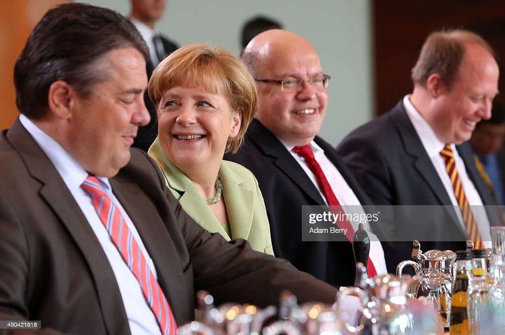 Vice Chancellor and Economy and Energy Minister <a gi-track='captionPersonalityLinkClicked' href=/galleries/search?phrase=Sigmar+Gabriel&family=editorial&specificpeople=543927 ng-click='$event.stopPropagation()'>Sigmar Gabriel</a> (SPD), German Chancellor <a gi-track='captionPersonalityLinkClicked' href=/galleries/search?phrase=Angela+Merkel&family=editorial&specificpeople=202161 ng-click='$event.stopPropagation()'>Angela Merkel</a> (CDU), Minister of the Chancellery Peter Altmeier (CDU), and Minister of State <a gi-track='captionPersonalityLinkClicked' href=/galleries/search?phrase=Helge+Braun&family=editorial&specificpeople=6740633 ng-click='$event.stopPropagation()'>Helge Braun</a> (CDU) arrive for the weekly German federal Cabinet meeting on June 11, 2014 in Berlin, Germany. High on the meeting's agenda was discussion over the country's arms export policies.