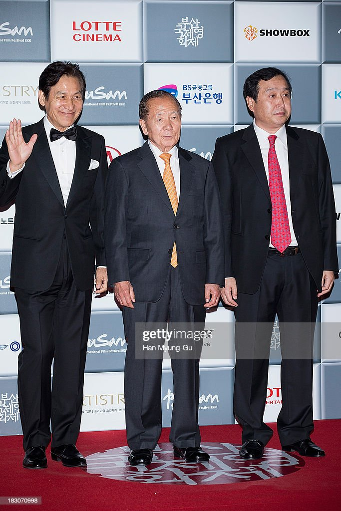 Vice Festival director Ahn Sung-Ki, honorary BIFF director <a gi-track='captionPersonalityLinkClicked' href=/galleries/search?phrase=Kim+Dong-Ho&family=editorial&specificpeople=961641 ng-click='$event.stopPropagation()'>Kim Dong-Ho</a> and deputy director Jay Jeon attend the opening ceremony during the 18th Busan International Film Festival on October 3, 2013 in Busan, South Korea. The biggest film festival in Asia showcases 299 films from 70 countries and runs from October 3-12.
