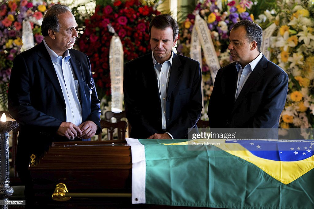Vice Major Fernando Pezao, Major Eduardo Paes and Governor Sergio Cabral attend the funeral of the Architect Oscar Niemeyer at Palacio City on December 06, 2012 in Rio de Janeiro, Brazil. Niemeyer was hospitalized for 33 days at Samarian Hospital and died at 104 years old due to a kidney infection on December 06, 2012 in Rio de Janeiro, Brazil.