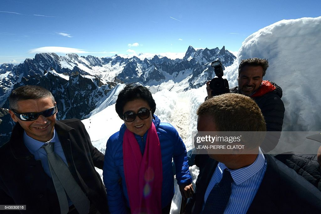 Vice Premier of China, Liu Yandong poses with the Aiguille Verte peak (L), Grandes Jorasses peak (Rear C-R) and the Dent du Geant peak (Rear R) in background, during her visit on June 29, 2016 at the top of the Aiguille du Midi mountain above Chamonix, French Alps. / AFP / JEAN