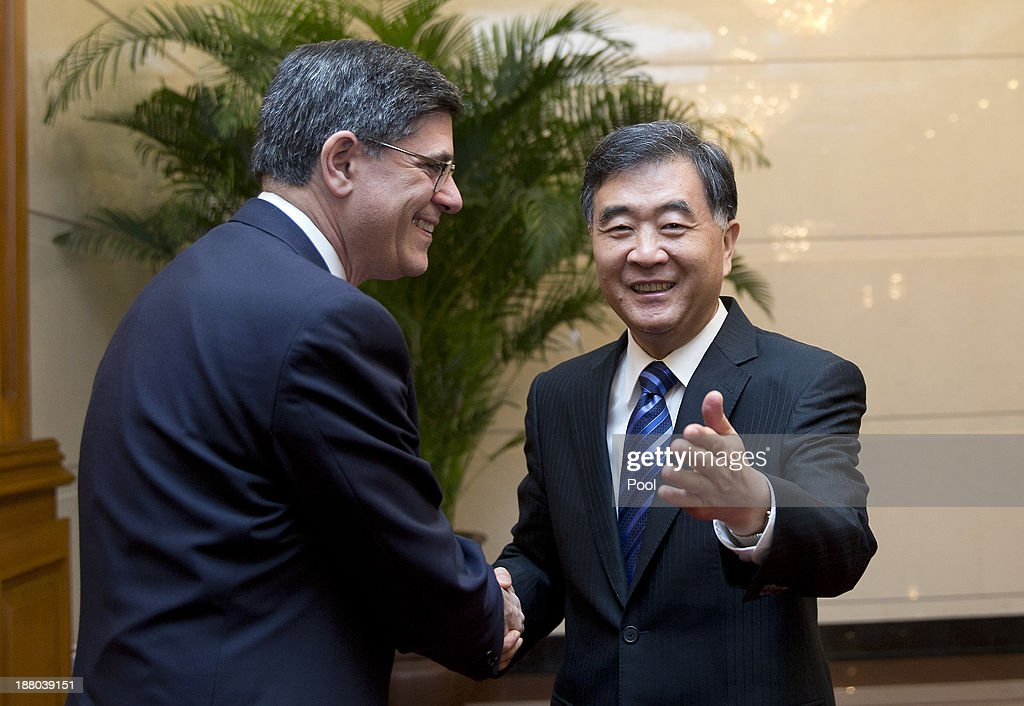 Vice Premier Wang Yang of China and U.S. Treasury Secretary Jacob Lew pose for photographs before their meeting at the Diaoyutai State Guesthouse on November 15, 2013 in Beijing, China.