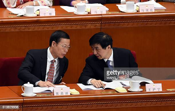 Vice premier Zhang Gaoli talks to Wang Huning a member of the Political Bureau of the CPC Central Committee during the opening ceremony of the...