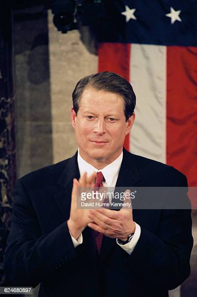 Vice President Al Gore applauds during the President Bill Clinton's State of the Union speech before a joint session of Congress on January 20 1999
