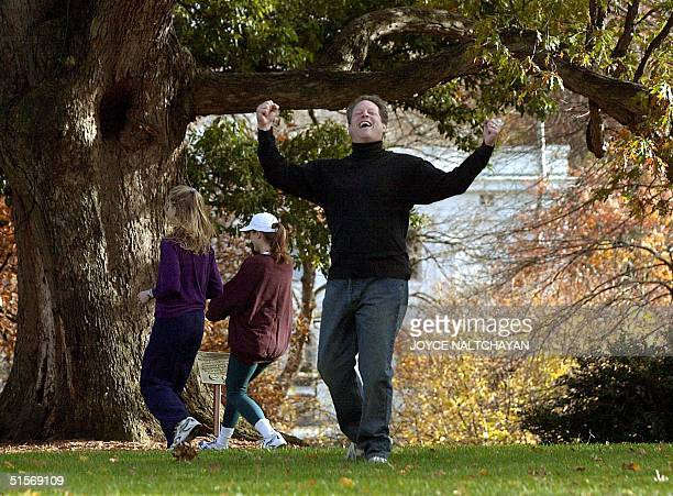 Vice President Al Gore celebrates scoring a touchdown as daughters Kristin and Karenna walk away during a touch football game with family members 10...