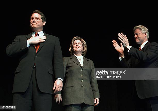 Vice President Al Gore covers his heart beside wife Tipper and US President Bill Clinton during a 'Celebration of the Swearingin of Senator Hillary...