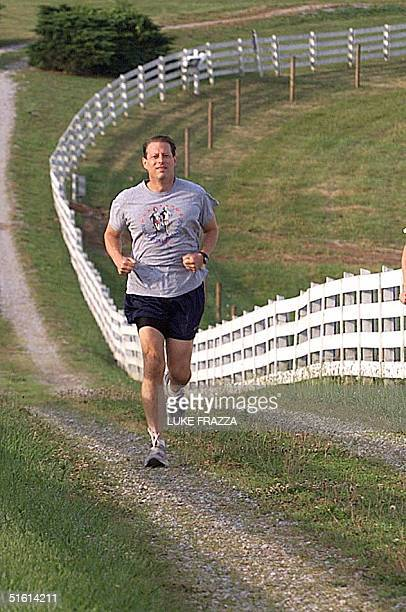 Vice President Al Gore jogs on his farm 16 June 1999 in Carthage TN Gore is scheduled to announce his candidacy for the US Presidency on16 June 1999...