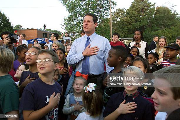 Vice President Al Gore joins children in the pledge of allegiance at the school yard of Jefferson Elementary School as the Democratic presidential...