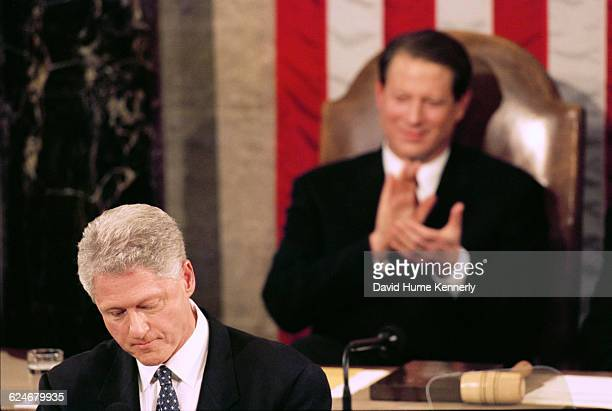 Vice President Al Gore listens to President Bill Clinton during the State of the Union speech before a joint session of Congress on January 20 1999