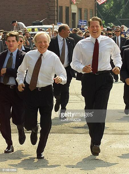 Vice President and Democratic presidential candidate Al Gore and his vice presidential running mate Sen Joseph Lieberman break into a jog as they...