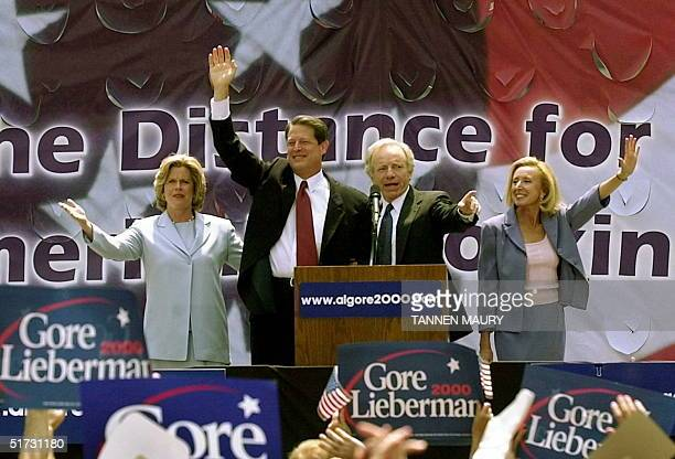 Vice President and Democratic presidential Candidate Al Gore his wife Tipper US Senator Joseph Lieberman DCT and his wife Hadassah wave after a rally...