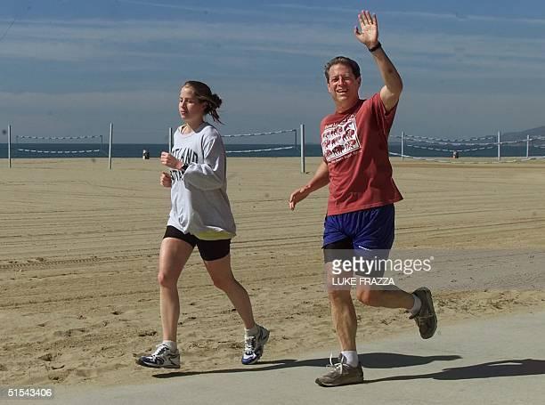 US vice president and Democratic presidential hopeful Al Gore and his daughter Kristin jog on the beach 01 March 2000 in Santa Monica California Gore...