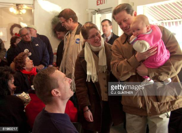 Vice President and Democratic Presidential Hopeful Al Gore holds sixmonthold Gabrielle Proska as her father Robert Proska and Sarah Gore look on at...
