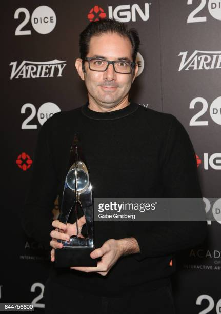 Vice President and game director of Blizzard Entertainment Jeff Kaplan poses with the Action Game of the Year award for Overwatch during the 20th...