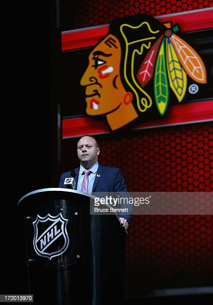 Vice President and General Manager Stan Bowman of the Chicago Blackhawks speaks at the podium during the 2013 NHL Draft at the Prudential Center on...