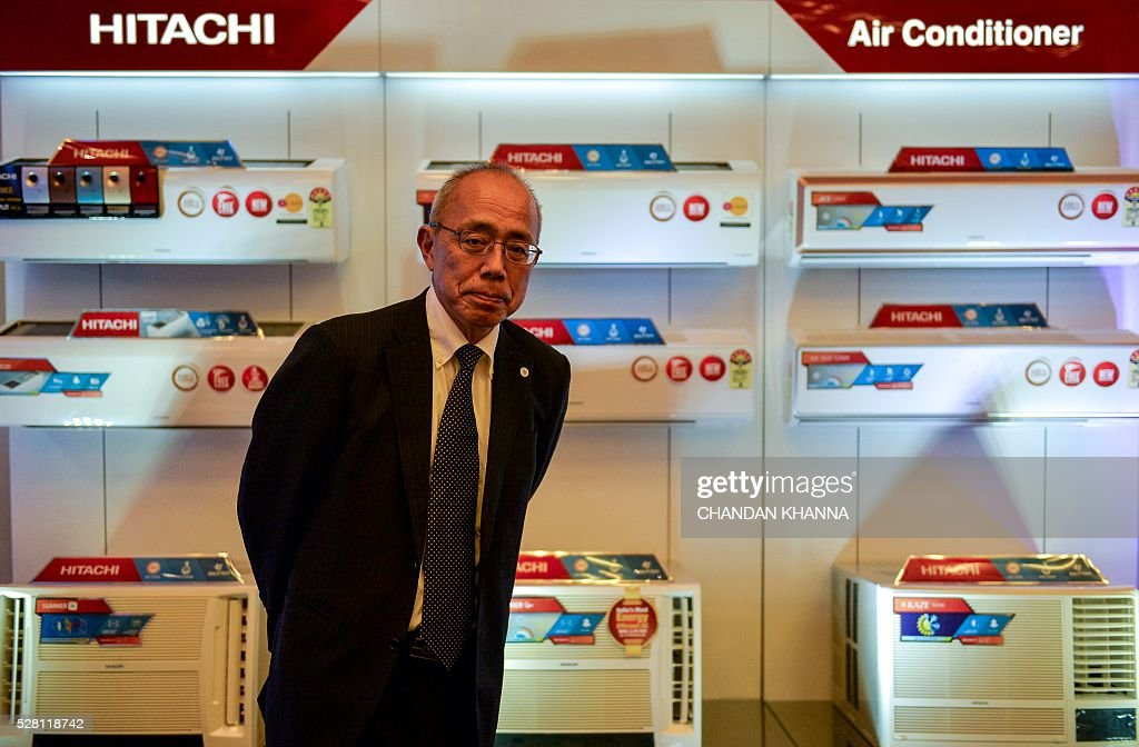 Vice President and Genral Manager Residential Business Unit Johnson Controls-Hitachi Air Conditionong, Shoji Tsubokuta looks on during a media event in New Delhi on May 4, 2016. / AFP / CHANDAN