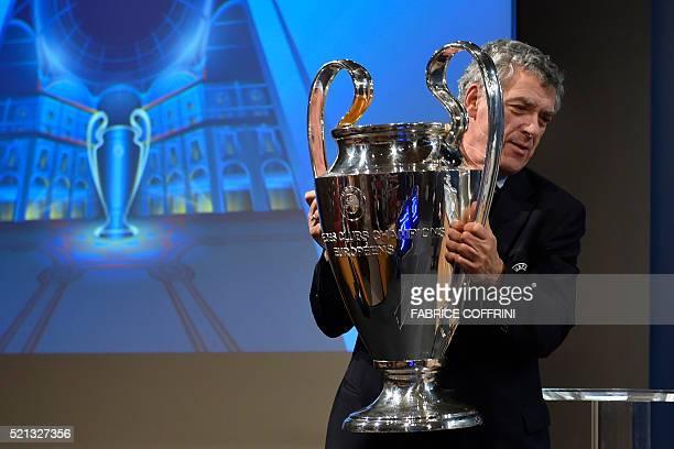 Vice President Angel Maria Villar Llona of Spain holds the UEFA Champions League trophy during the UEFA Champions League semifinal draw at the UEFA...