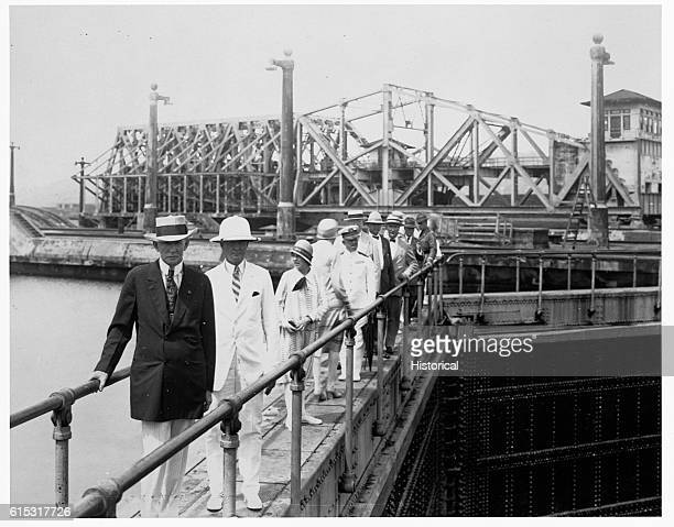 Vice President Charles G Dawes poses for a portrait with others at locks gate Panama Canal Canal Zone February 1927 | Location Locks Gate Panama...