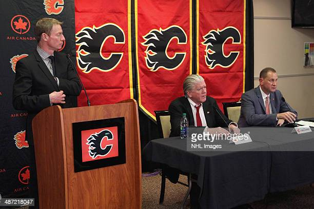 Vice President Communications Peter Hanlon of the Calgary Flames opens the floor for questions from the media during the introduction of new General...
