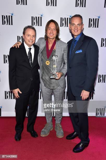 Vice President Creative Nashville Jody Williams singersongwriter Keith Urban and BMI President CEO Mike O'Neill attend the 65th Annual BMI Country...