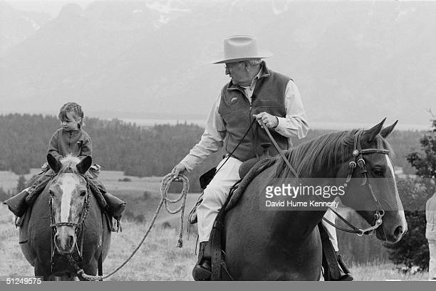Vice President Dick Cheney and his grandaughter ride horses August 18 2004 near Moose Wyoming