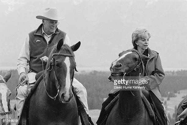 Vice President Dick Cheney and his wife Lynn Cheney ride horses together August 18 2004 near Moose Wyoming