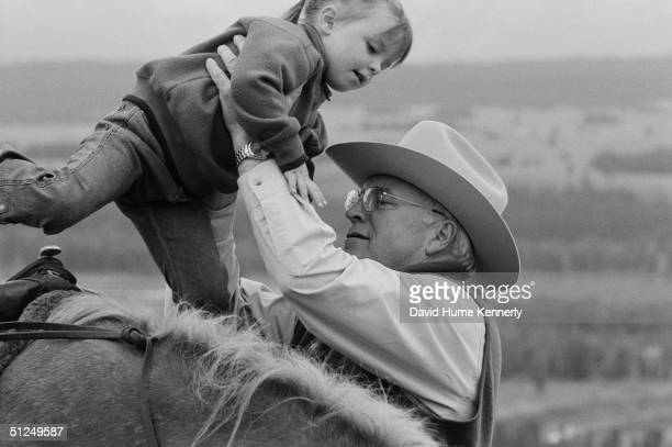 Vice President Dick Cheney lifts his granddaughter off of a horse August 18 2004 near Moose Wyoming