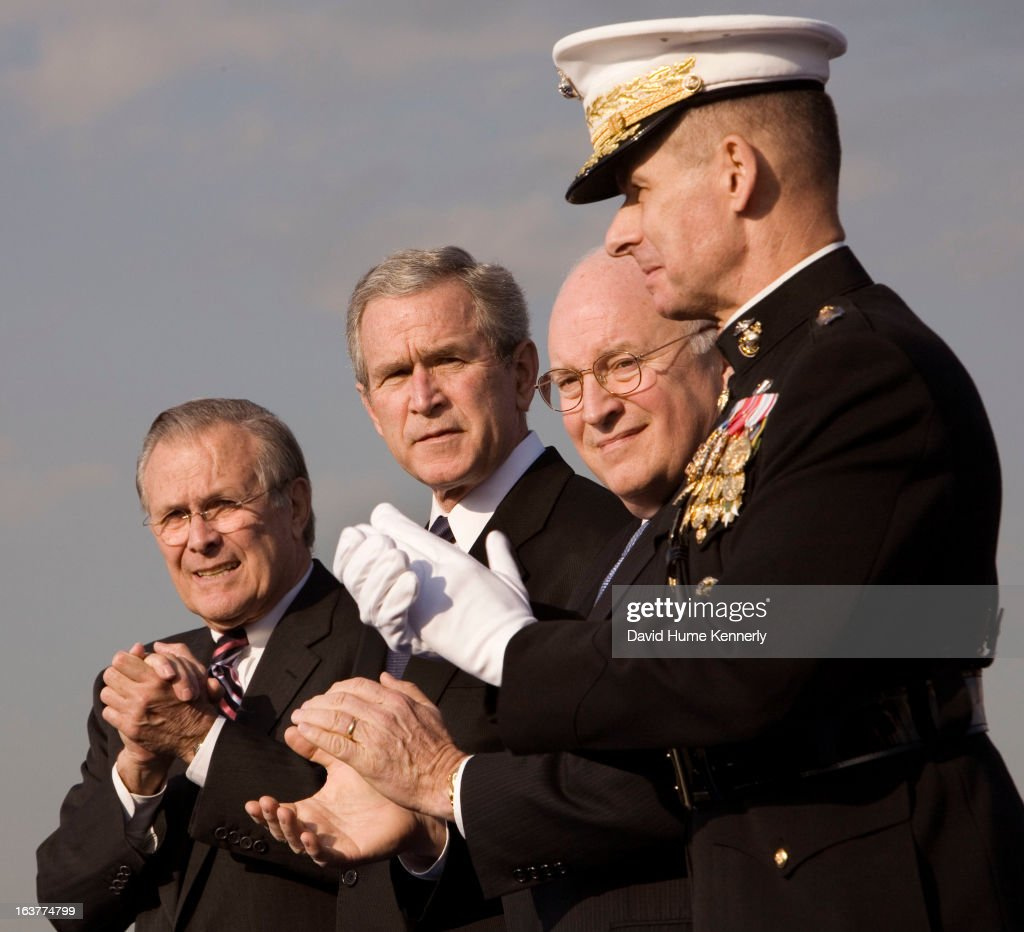Vice President Dick Cheney photographed from 1975 to 2006 in Washington, DC. Pictured: President G.W Bush, outgoing Secretary of Defense Rumsfeld, Chairman of the Joint Chiefs of Staff General Peter Pace and VP Cheney, at the departure ceremony for Rumsfeld, December 15, 2006.