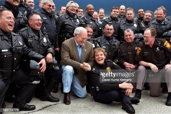 Vice President Dick Cheney photographed from 1975 to 2006 in Washington DC Pictured VP Cheney posing wtih members of the Milwaukee Wisconsin police...