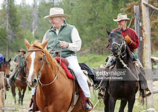 Vice President Dick Cheney rides a horse August 18 2004 near Moose Wyoming