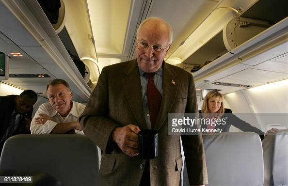 Vice President Dick Cheney with his chief of staff Lewis 'Scooter' Libby and daughter Liz Cheney behind him aboard Air Force 2 during the last stages...