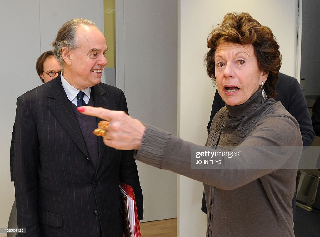 EU Vice President Digital Agenda Neelie Kroes (R) welcomes French's Culture and Communications minister Frederic Mitterrand prior to their bilateral meeting at the EU headquarters in Brussels on February 09, 2012.