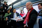 Vice President elect Joe Biden and Presidentelect Barack Obama speaks with passengers on the train en route to Baltimore during his inaugural whistle...