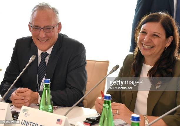 Vice President EU Government Affairs at Microsoft John Franck smiles next to US Acting Secretary of the Department of Homeland security Elaine Duke...
