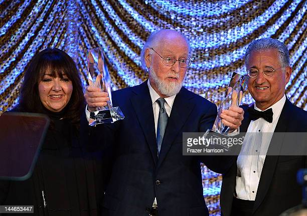 Vice President Film and Television Relations Doreen Ringer Ross composer John Williams and BMI President and CEO Del Bryant at the 60th Annual BMI...