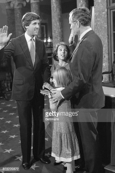 Vice President George Bush swears in Senator John Kerry of Massachusetts at the opening of the 99th Congress Kerry's daughters Alexandra and Vanessa...